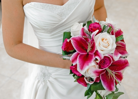 pink wedding: Bride holding wedding bouquet