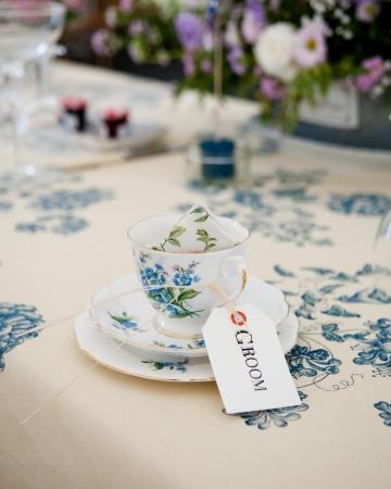 Very English Vintage tea cup set at wedding reception. photo