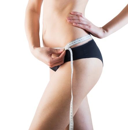 허리의 잘룩 한 선: sporty woman with slim body measuring waistline