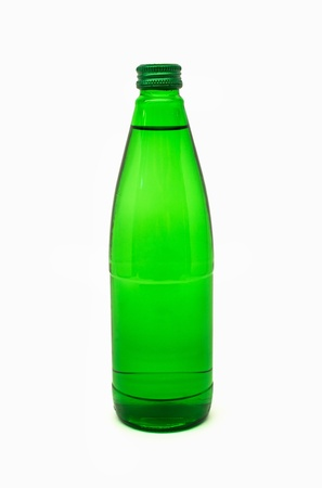 green glass bottle: green glass bottle with mineral water , isolated on white background