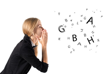 word of mouth: businesswoman talking and letters coming out of her mouth Stock Photo