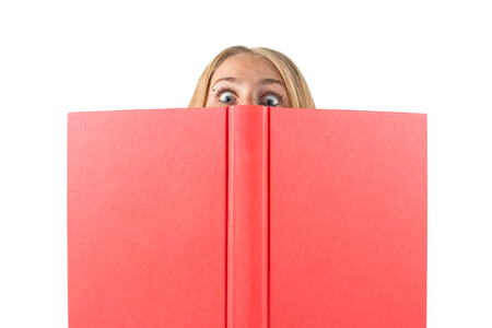 big woman: girl  woman  with big eyes looking for stack of books isolated on white background