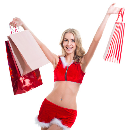 Happy smiling woman in santa claus clothes with bags  Concept - sale, shoppingwinter, christmas, x-mas, happiness, new year photo