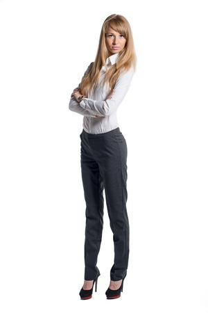 woman white shirt: Portrait of young business woman white shirt black trousers pants  isolated Stock Photo