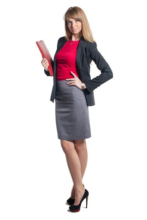 secretary skirt: Portrait of young business woman with red folder gray skirt shirt classical costume, isolated on white background Stock Photo