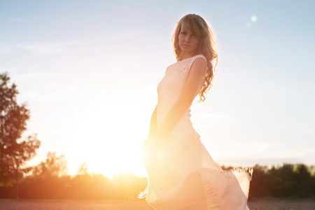 area sexy: Young woman under sunset light, outdoors portrait  Soft light and Sunshine