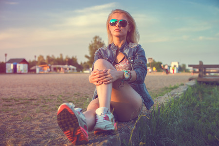 sexy nude blonde: Beautiful fashion young woman sunglasses sitting and posing at sunset Sunny outdoors portrait  Stock Photo