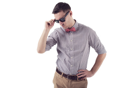 enticement: Young man hipster with red bow tie and sunglasses  in shirt with short sleeves