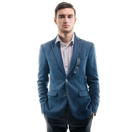 hands in pockets: Young handsome guy standing alone with his hands pockets.