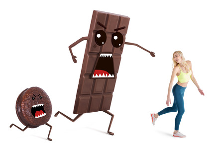 Pretty girl on a diet  controls her weight. Concept running away from temptations like chocolate and sweets Stock Photo