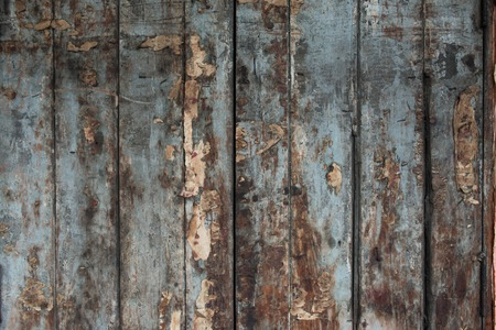 Old damaged wooden wall or fence aged and weathered