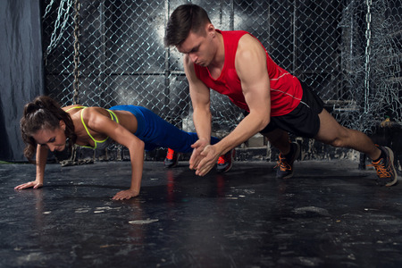 push: Sportsmen. fit male trainer man and woman doing clapping push-ups explosive strength training concept crossfit fitness workout strenght power.