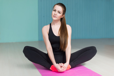 health   fitness: woman doind exercise butterfly for flexible legs concept sport health fitness aerobics gymnastic.