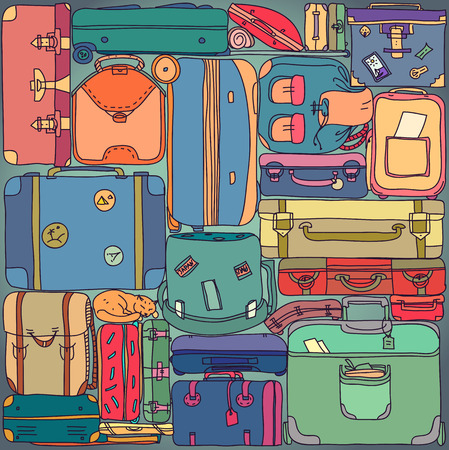 Collection of vintage travel suitcases with stickers.