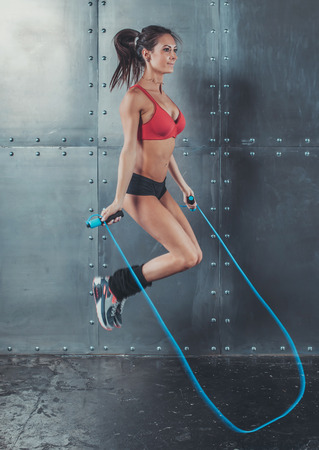 woman rope: Sporty woman jumping skipping rope concept sport health fitness loss weight cardio training workout wellness