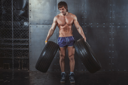 powerlifting: Sportsman athlete crossfit man working out exercising with a tires powerlifting healthy lifestyle bodybuilding concept Stock Photo