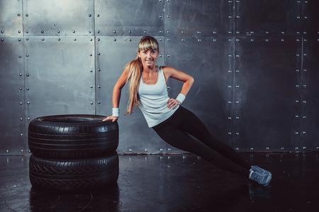 Fitness fit woman sport model doing core, push-ups training workout.