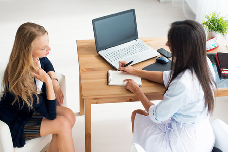 Medical physician doctor woman writing prescription taking notes in office and patient