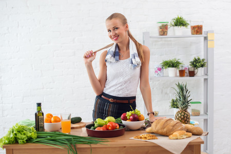 happy smiling: Woman preparing dinner in a kitchen concept cooking, culinary, healthy lifestyle Stock Photo