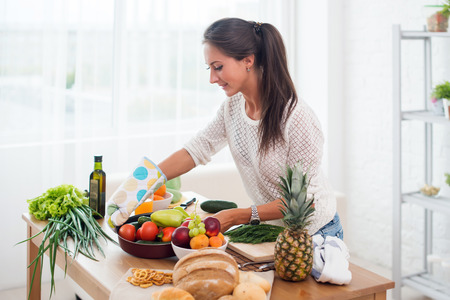 Woman preparing dinner in a kitchen concept cooking, culinary, healthy lifestyle Archivio Fotografico