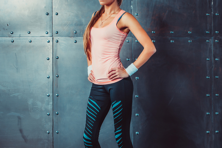 perfect female body: Sportswoman showing perfect female body in sports clothing sportswear concept sport healthy lifestyle Stock Photo