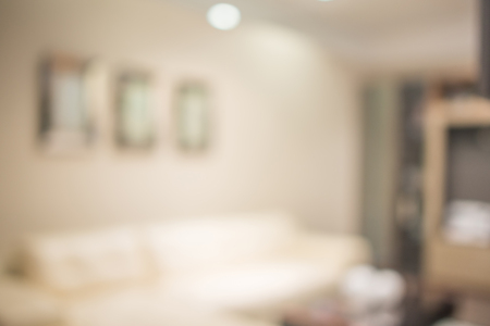 domestic scene: Abstract defocused blurred background blur image of living room. Stock Photo