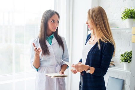 Medical physician doctor woman talking to patient explaining diagnosis prescribe concept healthcare, medical, hospital