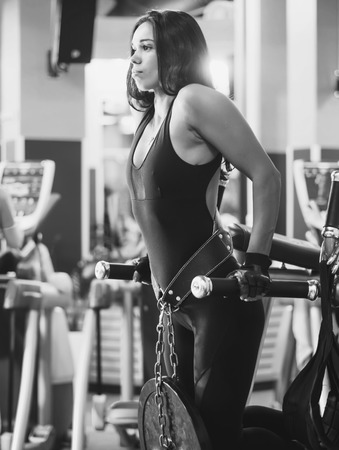 dips: Athlete woman workout out arms on dips horizontal parallel bars Exercise training triceps and biceps doing push ups