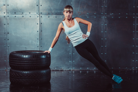 cross street with care: Fitness fit woman sport model doing core, push-ups training workout.