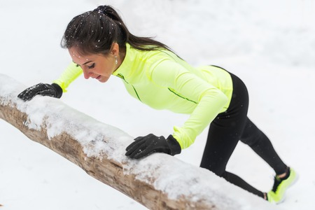 fitness training: Fitness woman doing push ups Outdoor training workout winter forest Stock Photo