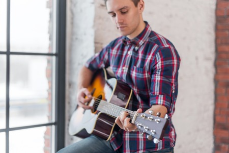 chord: Man practicing in playing guitar focus on hand and chord. Stock Photo