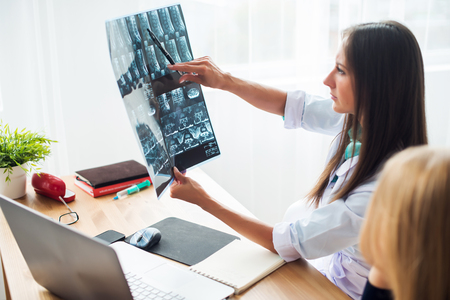 roentgen: Woman doctor in hospital looking at x-ray film healthcare, roentgen, people and medicine concept Stock Photo