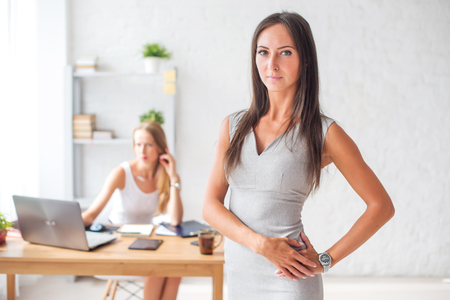 white woman: Pretty businesswoman looking at camera and smiling