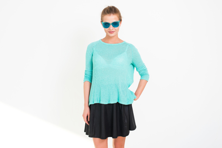 view girl: Young blond model posing in studio, performing new fashion glamour look, wearing sunglasses, putting her arm on the hip, looking at camera, not isolated Stock Photo