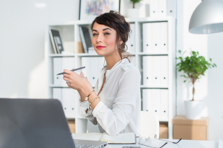 getting ready: Young attractive office worker drinking cup of tea, having coffee break in the morning, getting ready for work day Stock Photo