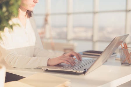 coder: Working with laptop woman writing a blog. Female hands on the keyboard. Stock Photo