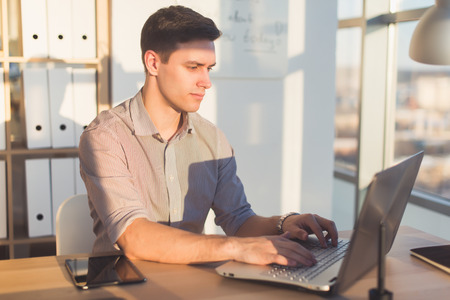 Man typing text or blog in office, hir workplace, using pc keyboard. Busyman working Stock Photo