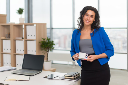 business attire teacher: Successful business woman looking confident and smiling