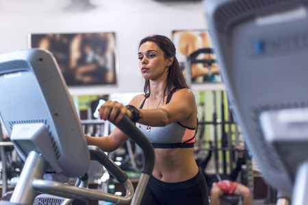 crosstrainer: Woman exercising at the gym in an elliptical trainer Cardio training Stock Photo