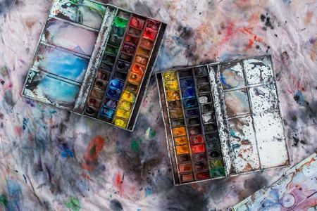 Watercolor aquarelle paints in box with palette.