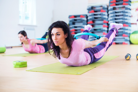 Fit woman stretching training back extension exercise Stock Photo