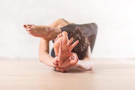 jnana: Woman doing yoga meditation and stretching exercise