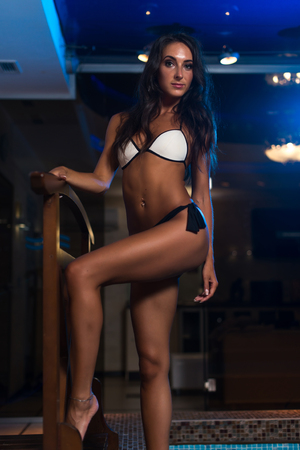 chic panties: Fit sexy young woman in underwear standing posing.
