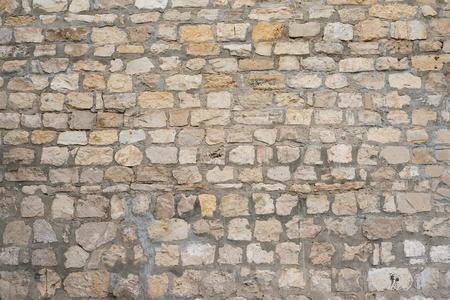 Partie d'un mur de pierre inégale avec du ciment Fond, texture Banque d'images - 80041010