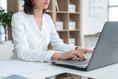 teleworking: Businesswoman typing on laptop at workplace Woman working in office hand keyboard
