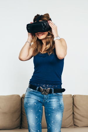 Woman at home using virtual reality headset
