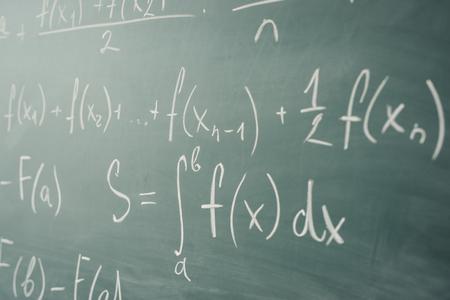 Math class. Algebra. The formulas are written on the school board.