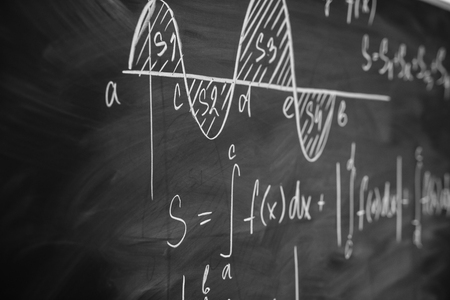 Mathematics function integra graph formulas on the chalkboard. Stock fotó
