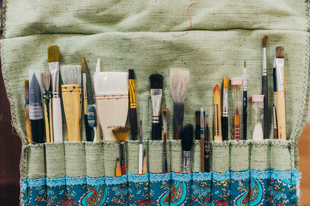 Brushes. Paintbrush collection top view. Artists workplace. Imagens