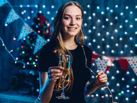 Woman in evening dress with glass of sparkling wine Celebration new year, christmas